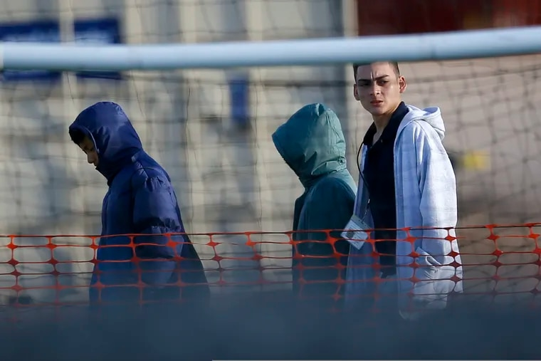 Migrant teens walk inside the Tornillo detention camp in Tornillo, Texas, Thursday, Dec. 13, 2018. The Trump administration announced in June 2018 that it would open the temporary shelter for up to 360 migrant children in this isolated corner of the Texas desert. Six months later, the facility has expanded into a detention camp holding thousands of teenagers. (AP Photo/Andres Leighton)