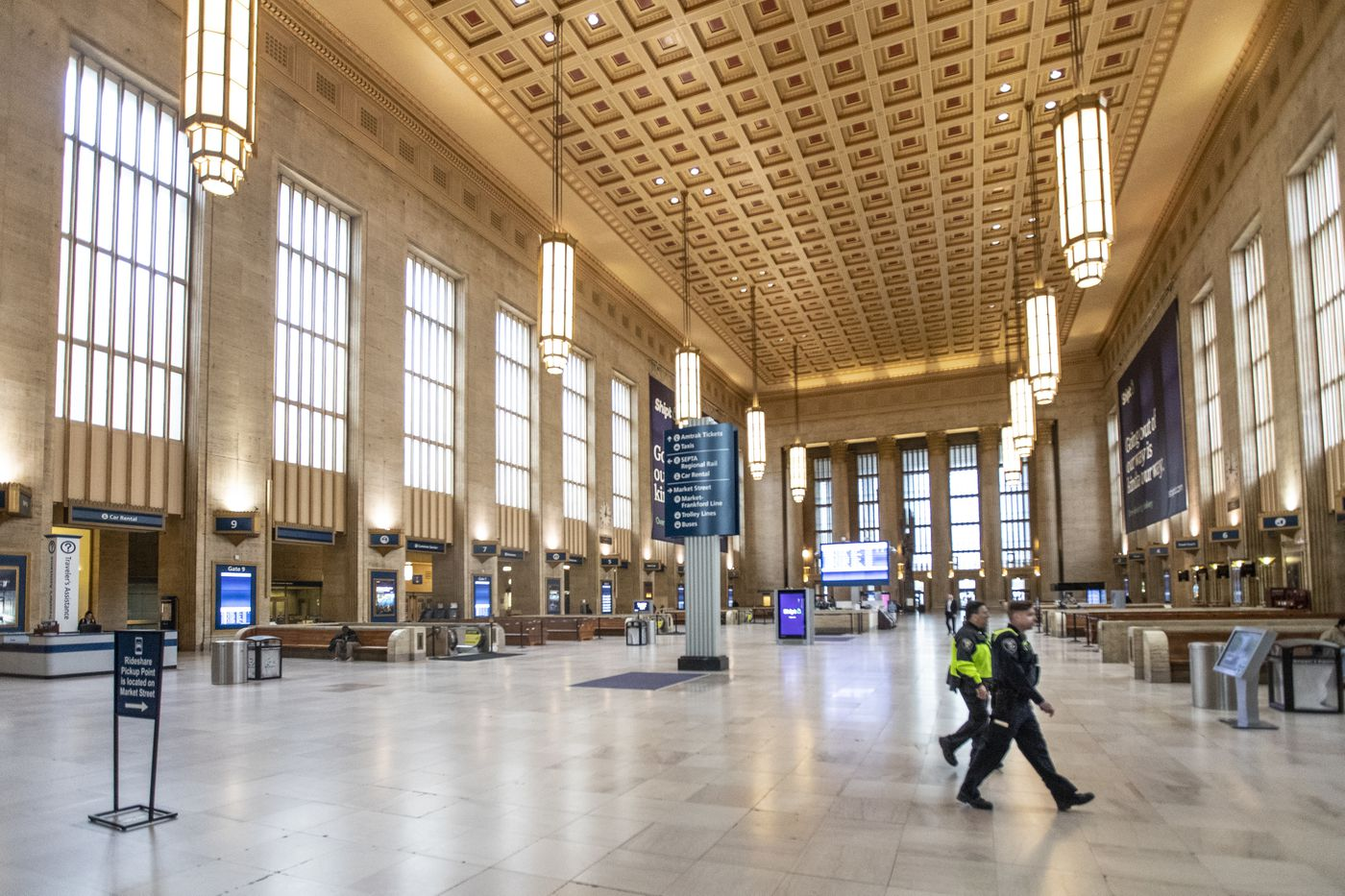 Amtrak Police walk through an almost empty 30th Street Station on March 23, 2020, the first day of the stay at home policy mandated by Philadelphia City Mayor Jim Kenney as an answer to the growing coronavirus.