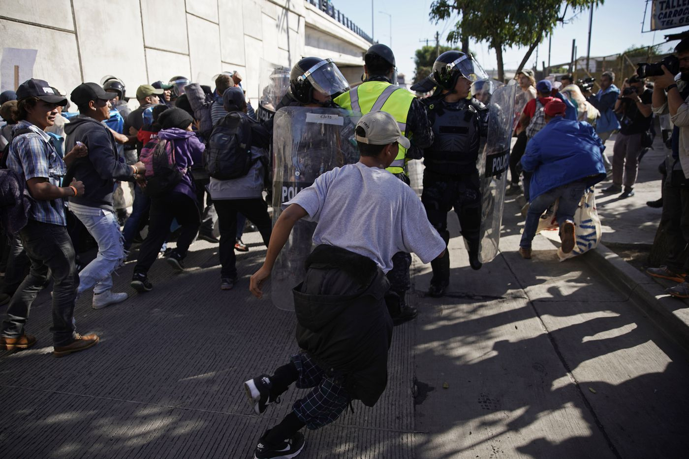 U.S. agents fire tear gas as some migrants try to breach fence