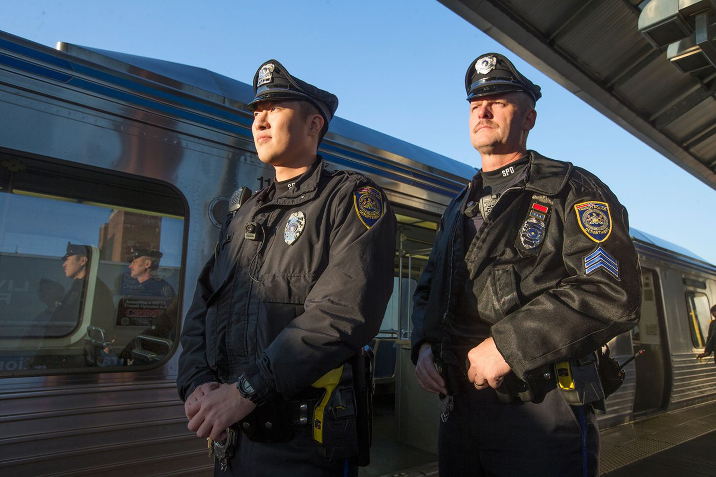 SEPTA officers show allegiance to their uniforms, and the flag