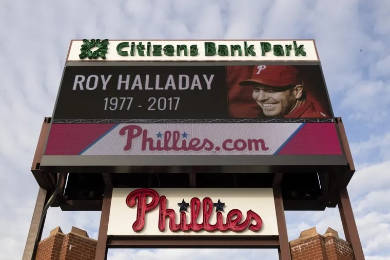 A sign outside Citizens Bank Park displays a message of remembrance of former Phillies pitcher Roy Halladay in Philadelphia, Wednesday, Nov. 8, 2017. Halladay, a two-time Cy Young Award winner who pitched a perfect game and a playoff no-hitter for the Phillies, died Tuesday when his private plane crashed into the Gulf of Mexico. He was 40.