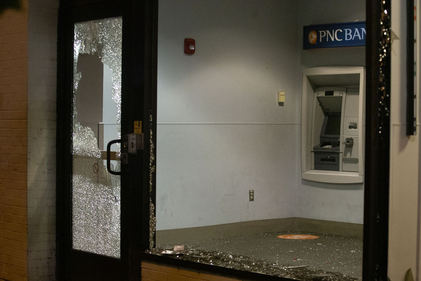 The shattered windows at a PNC Bank branch on 40th Street near Walnut. The windows were destroyed by a group of protesters marching in response to the Jacob Blake shooting in Wisconsin.