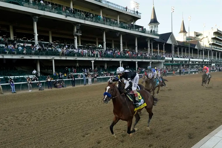 Jockey John Velazquez riding Authentic wins the 146th running of the Kentucky Derby at Churchill Downs, Saturday, Sept. 5, 2020, in Louisville, Ky.