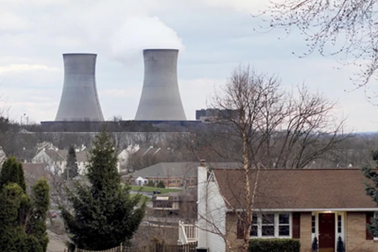 The Limerick nuclear plant's cooling towers loom behind a house on Winding Road in Pottstown.