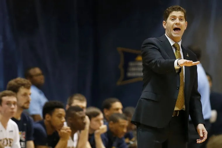 Drexel coach Zach Spiker yells to his team during a February game against James Madison.
