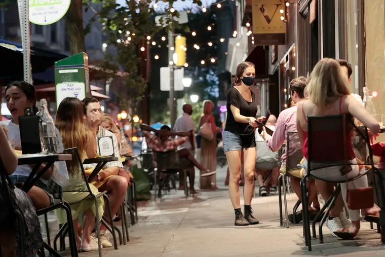 Outdoor diners eat at Lolita in Philadelphia on July 3.