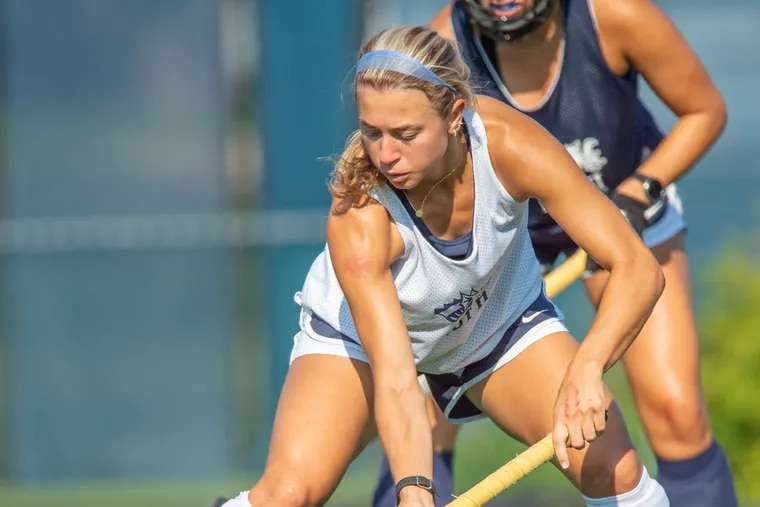 Drexel University forward Hannah Nihill takes control of the ball during field hockey practice.