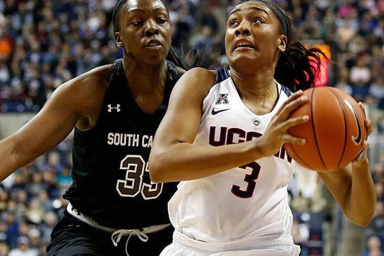 Connecticut Huskies forward Morgan Tuck (3) drives the ball against South Carolina Gamecocks center Elem Ibiam (33) in the first half at Harry A. Gampel Pavilion. UConn defeated South Carolina 87-62. (David Butler II/USA Today)
