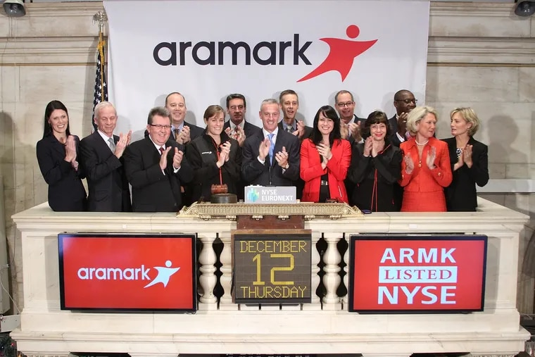 FILE photo shows Eric Foss, President and Chief Executive Officer of Aramark ringing the Opening Bell at the New York Stock Exchange on December 12, 2013. Aramark has been in the news for not paying bonuses to thousands of managers and the lack of communication around it. (Photo by Ben Hider/NYSE Euronext)