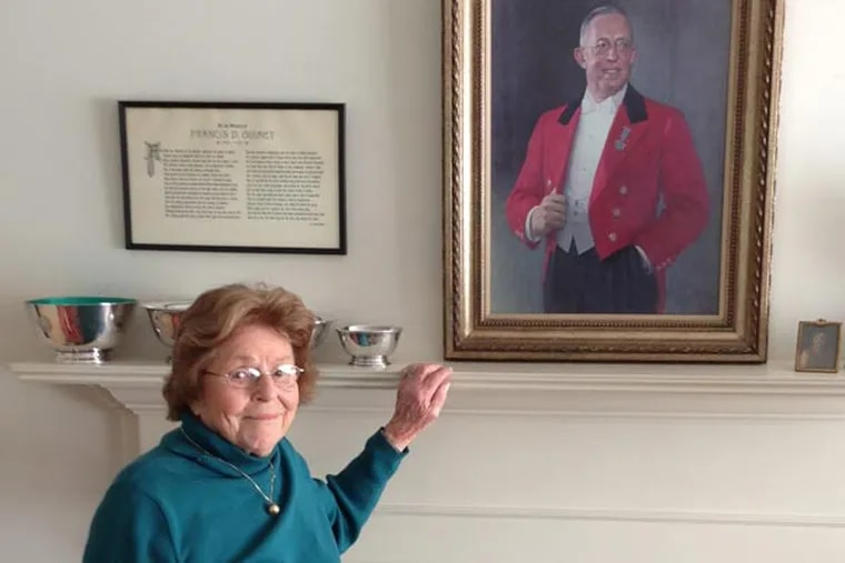 In her Cape Cod home, Barbara McLean standing by a painting of her father, Francis Ouimet, painted in 1953 by soon-to-be-President Dwight Eisenhower. The painting was placed in a cottage at the Augusta National Golf Club, and later went to the Royal and Ancient Golf Club of St. Andrews. (Photo courtesy of Francis Ouimet Scholarship Fund)