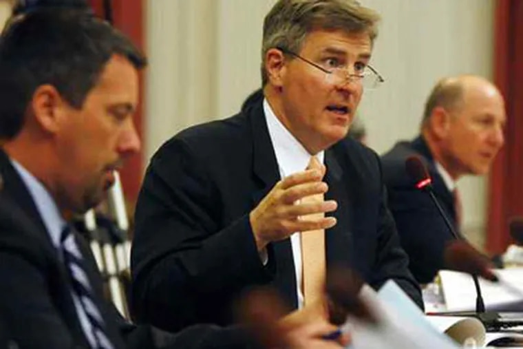New Jersey Education Commissioner Bret Schundler answering questions during an Assembly Budget Committee hearing. (file photo)