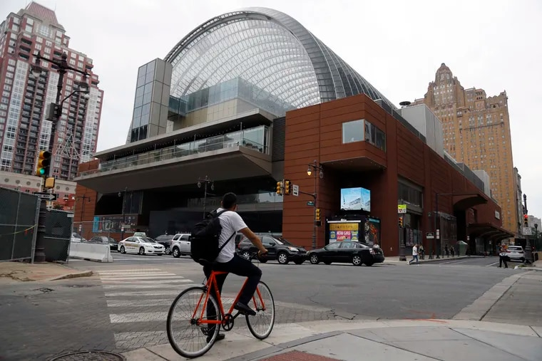 A cyclist passes by the Kimmel Center for the Performing Arts in August 2019.