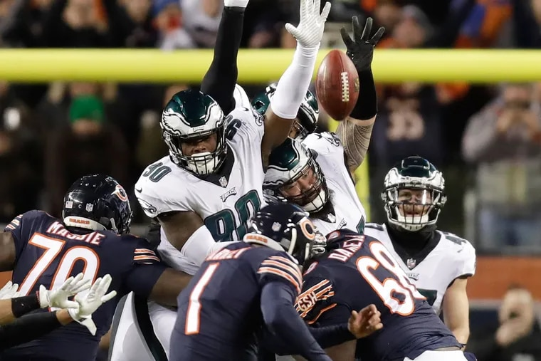 Eagles defensive tackle Treyvon Hester and Eagles defensive tackle Haloti Ngata leap after the football on Chicago Bears kicker Cody Parkey game winning field goal late in the fourth-quarter in NFC Wildcard playoff game on Sunday, January 6, 2019 in Chicago.  Parkey missed and the Eagles won 16-15.
