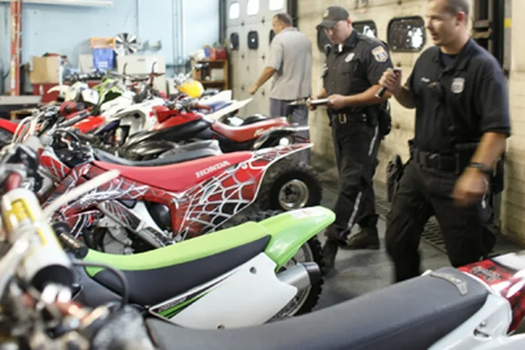Police with confiscated ATVs and dirt bikes. (Joseph Kaczmarek / For the Daily News)