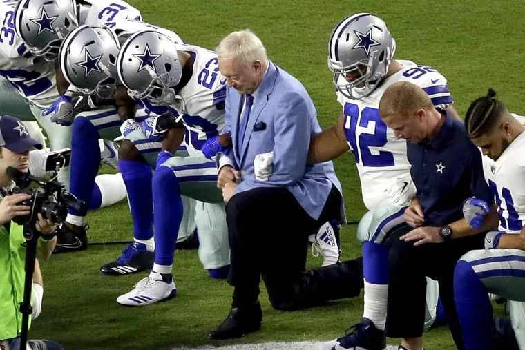 Before he threatened players who protest the national anthem, Cowboys owner Jerry Jones knelt with his team before  a game against Arizona in September.