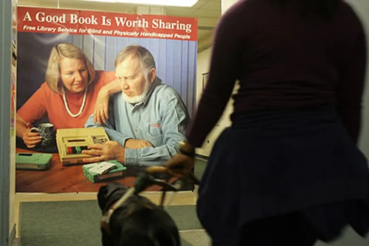 Nana Osei, 23, walks with her guide dog Nevan through Philadelphia's Library for the Blind. (David Swanson / Staff Photographer)