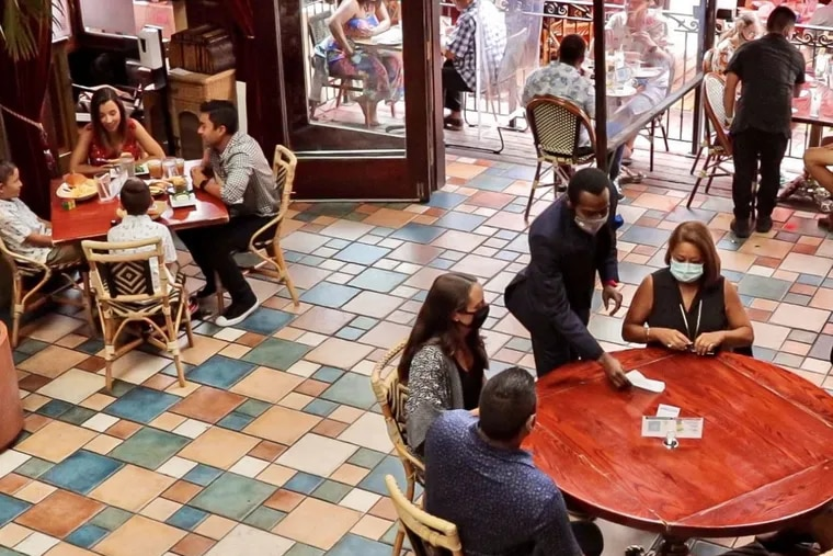 Patrons dine indoors at Cuba Libre restaurant in Old City after the city lifted its restriction.