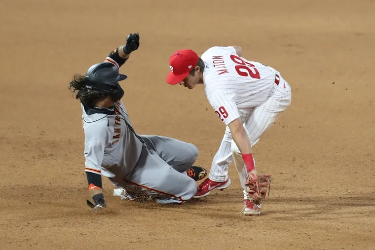 Rookie shortstop Nick Maton tags out Brandon Crawford of the Giants.