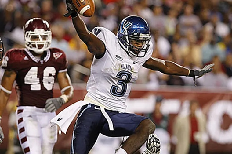 """""""You know that if you throw it up, he is definitely going to come down with it,"""" Villanova's quarterback Chris Whitney said of Harvey. (Ron Cortes/Staff Photographer)"""