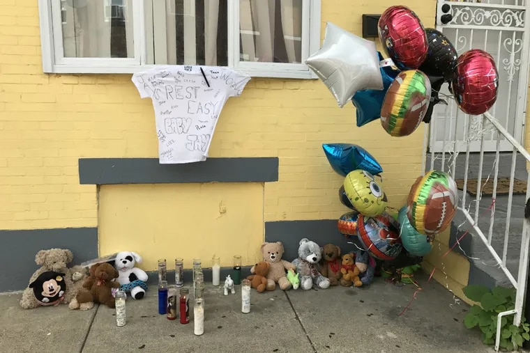 A memorial of candles, stuffed animals, and balloons were seen Friday, Aug. 3, 2018, outside a Port Richmond rowhouse, where a toddler was fatally mauled by pit bulls on Wednesday, Aug. 1, 2018.