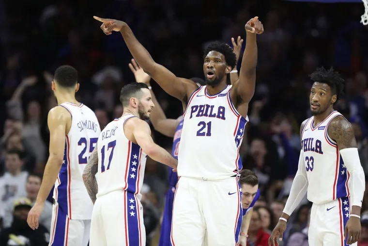 Joel Embiid, center of the Sixers leads the crowd in singing goodbye after Andre Drummond of the Pistons fouled out in the 4th quarter at the Wells Fargo Center on Dec. 2, 2017.
