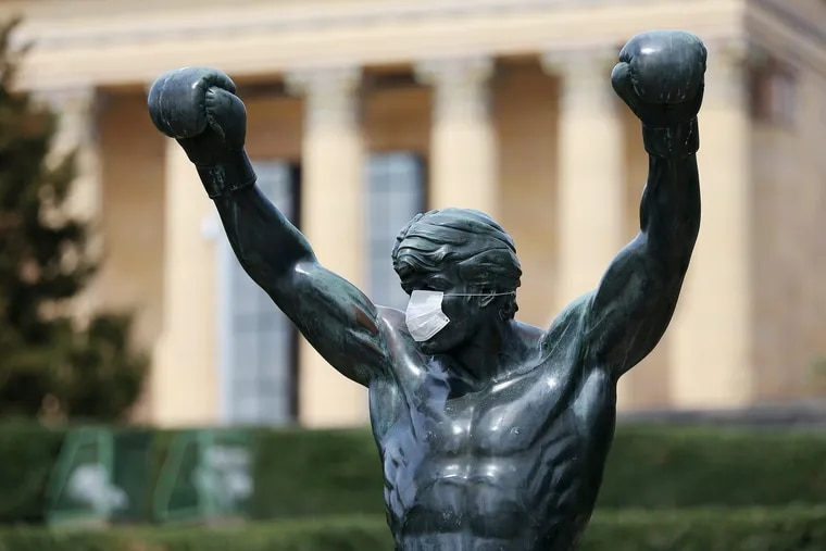A mask covers the face of the Rocky statue in front of the Philadelphia Museum of Art on April 17. People are encouraged to wear masks or face coverings to reduce the spread of the coronavirus.