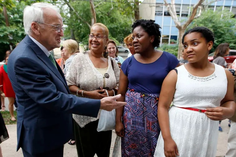 Kevin Concannon of the USDA talks to Clark Park Farmers Market regulars and West Phila. residents Denise Brice (second from left), Joanne Browley, and her daughter, Camryn Pearson. Concannon announced the SNAP expansion to include more farmers and markets.