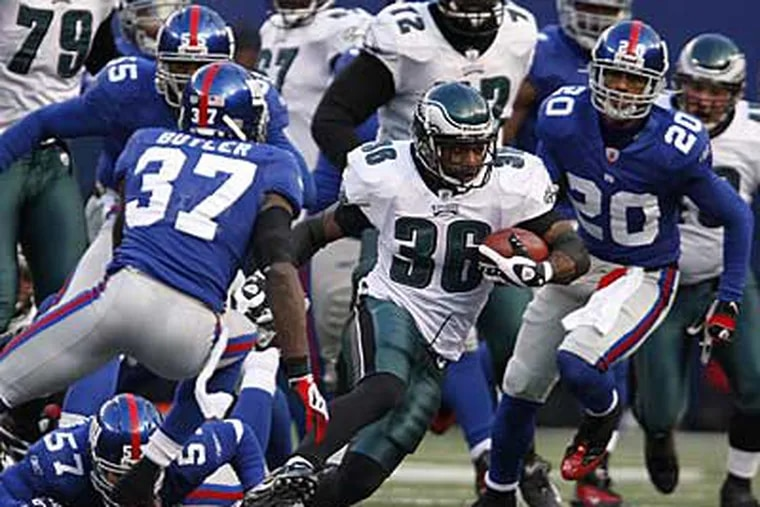 Brian Westbrook carried the ball a career-high 33 times in the Eagles' 20-14 win over the Giants. (Ron Cortes/Staff Photographer)