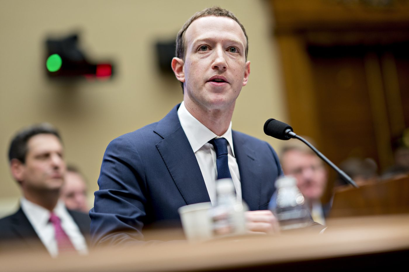 Zuckerberg says he and Sandberg will stay put, even after Facebook's scandals
