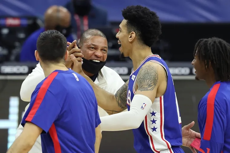 Sixers coach Doc Rivers celebrates with Danny Green of the SIxers after he hit a 3-pointer in the second half to force the Raptors to call a timeout.