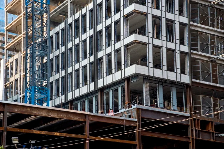 The Harper apartment tower on the former site of the Boyd Theatre's auditorium on Chestnut Street is beginning to take shape, and already has some of its cladding visible.