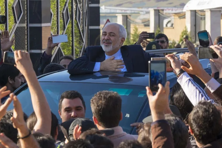 Iranian Foreign Minister Mohammad Javad Zarif , who signed the agreement Thursday, is cheered upon his return to Tehran's Mehrabad airport from the negotiations in Lausanne, Switzerland. MORTEZA NIKOUBAZL / Zuma Press / TNS