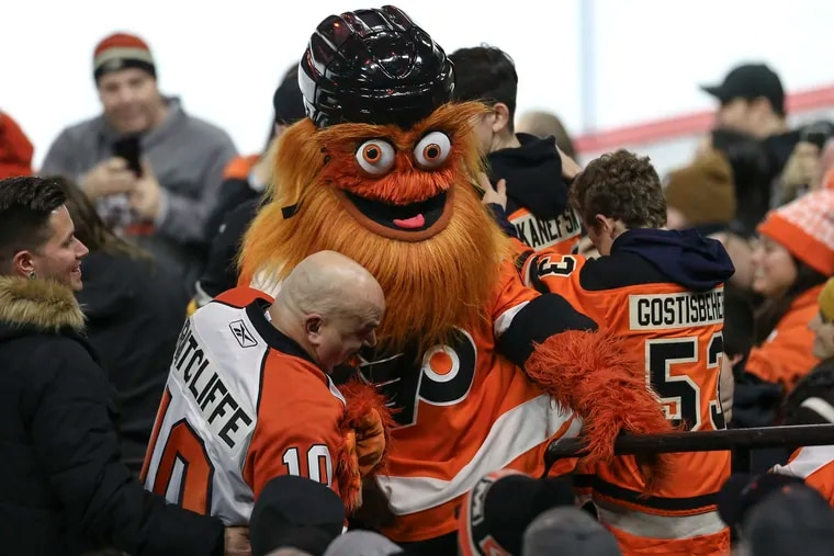 """In a """"before"""" pic from January, Flyers' mascot Gritty with fans at the Wells Fargo Center. Gritty's """"Queer Eye"""" makeover is now playing on YouTube."""