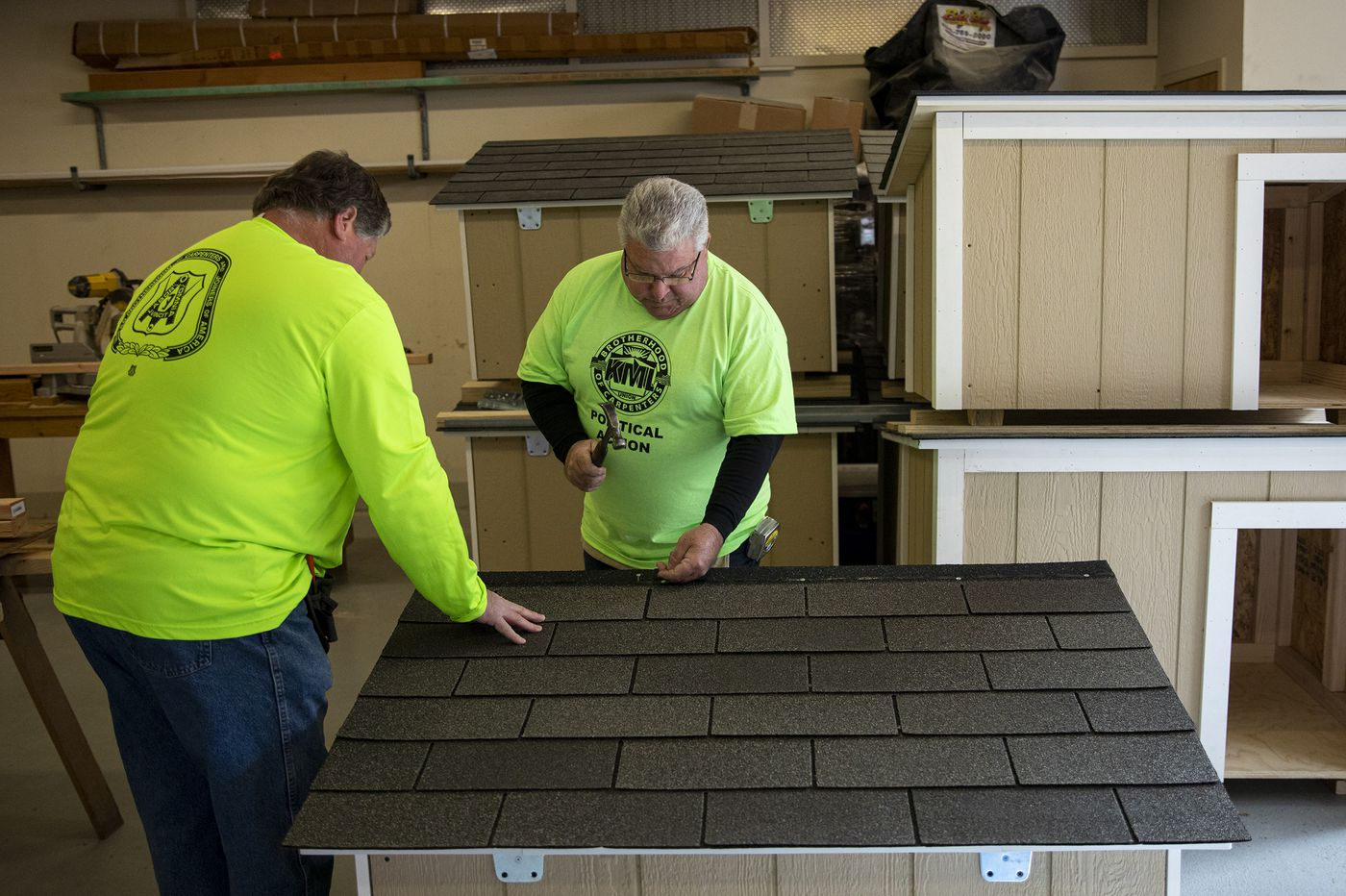 Union carpenters create free custom doghouses for the Pennsylvania SPCA