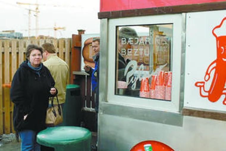 "Deborah Large Fox waiting to order ""the best hot dog in the world"" at Beajarins Bestu in Reykjavik, Iceland."