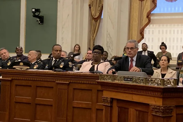 From left, Police Commissioner Richard Ross, Deputy Managing Director for Criminal Justice and Public Safety Vanessa Garrett Harley, and District Attorney Larry Krasner, at a hearing on gun violence on June 26, 2019.