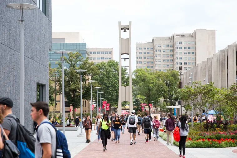 Students walk through the Temple University campus on the first day of the fall semester, August 26 2019.
