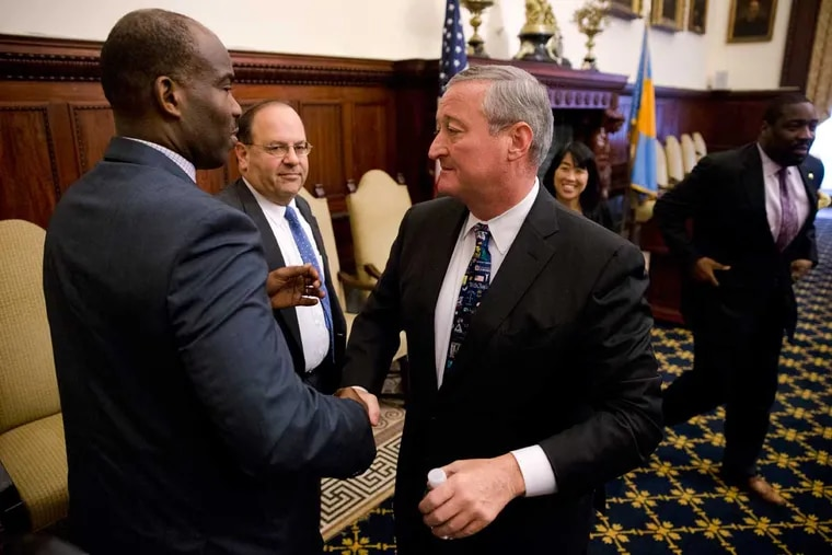 Philadelphia Mayor Jim Kenney shakes hands with City Councilman Derek Green during a news conference at City Hall in Philadelphia, Thursday, June 16, 2016. Philadelphia became the first major American city with a soda tax despite a multimillion-dollar campaign by the beverage industry to block it.