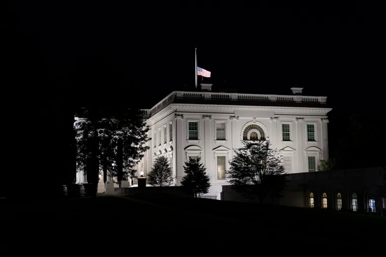 The flag at the White House flies at half-staff Friday, Sept. 18, 2020, in Washington, after the Supreme Court announced that Supreme Court Justice Ruth Bader Ginsburg has died of metastatic pancreatic cancer at age 87.