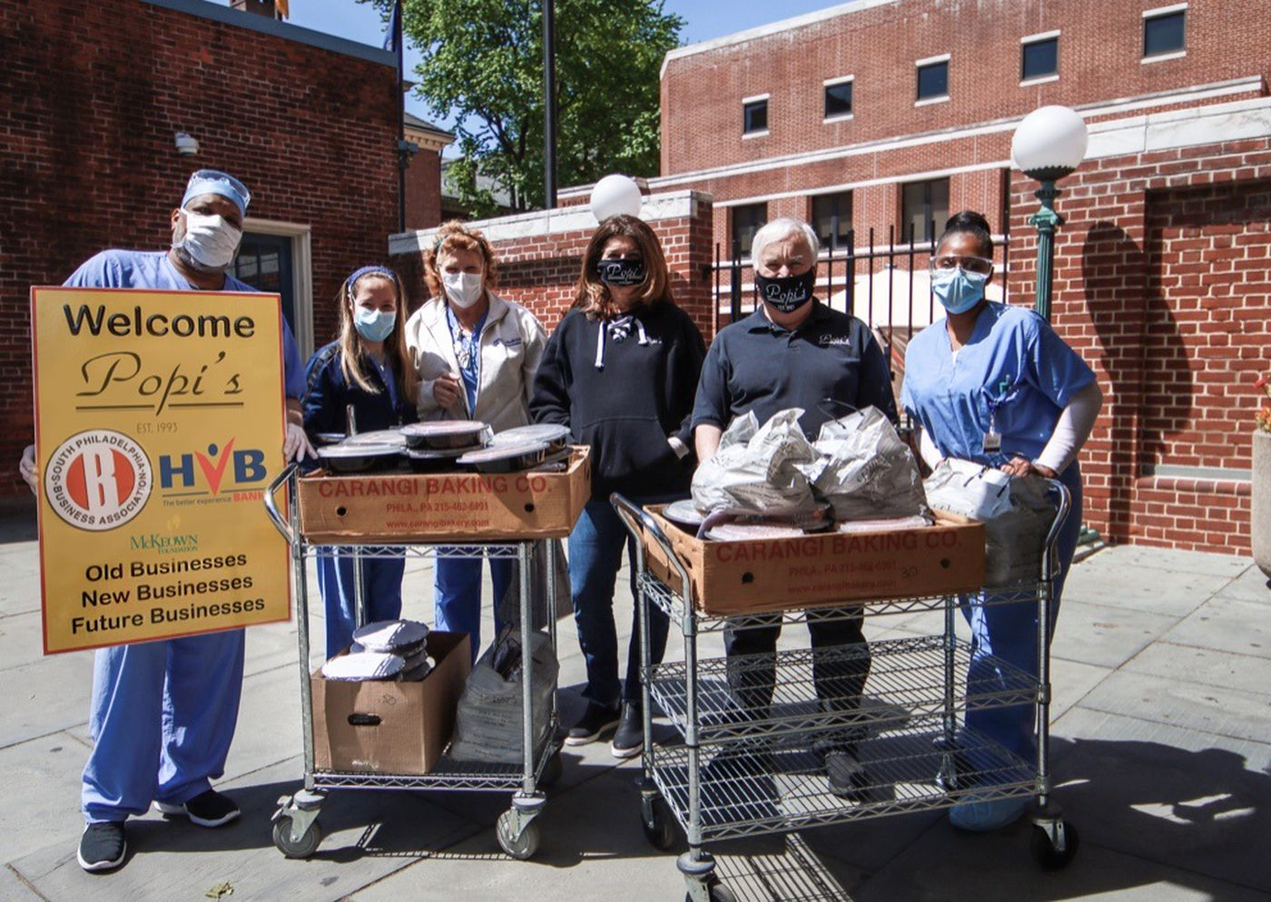 Popi's Restaurant owner Gina Rucci, third from left, delivers meals to customers during coronavirus.