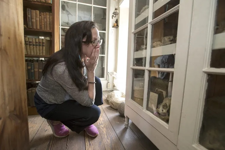 """Louellyn White, an assistant professor in the First Peoples Studies Program at Concordia University in Montreal, reacts to finding an American Indian skull in a cabinet in the Byberry Friends library on May 9, 2018. The skull was found while digging a canal near Lambertville, NJ. White is working with the Native American Boarding School Healing Coalition to search records and cemeteries for students who died while on """"Outing"""" at the Carlisle Indian School."""