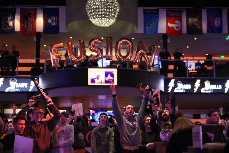 Philadelphia Fusion fans cheer at the Overwatch League season opener watch party