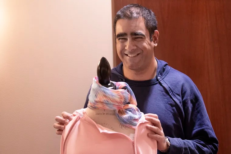 Chaitenya (Chat) Razdan, cofounder and CEO of Care+Wear, with one of the company's port-access shirts available for sale at the Cancer Treatment Centers of America facility in Philadelphia. He considers the Philadelphia region a promising market for his company's more dignified health-care clothing.