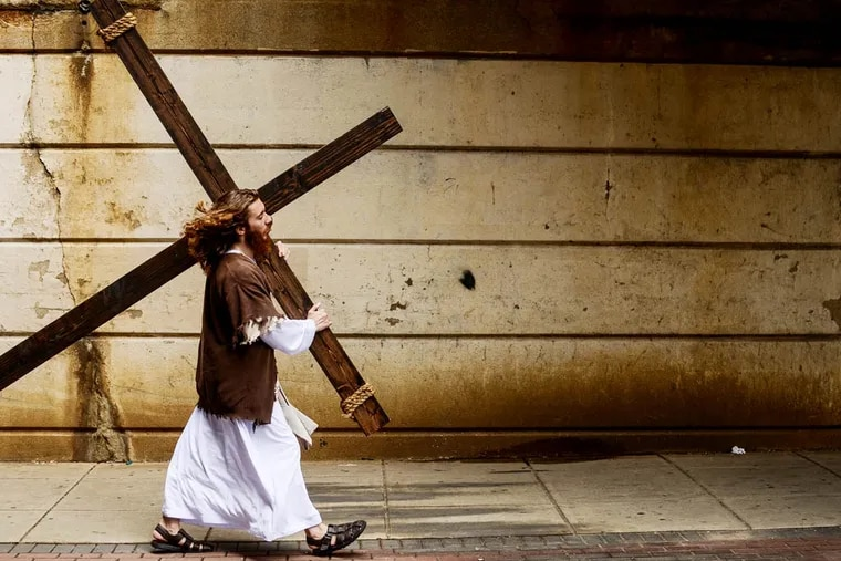 Philly Jesus passes under an overpass in North Philadelphia.  Andrew Thayer / Staff Photographer