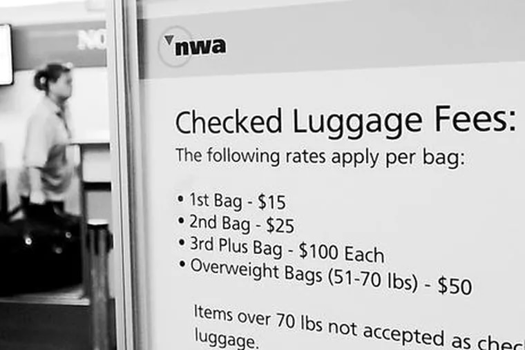A sign with luggage fees at a Northwest Airlines ticket counter in Freeland, Mich., in September. The fees were begun to offset high oil prices, but they remain.