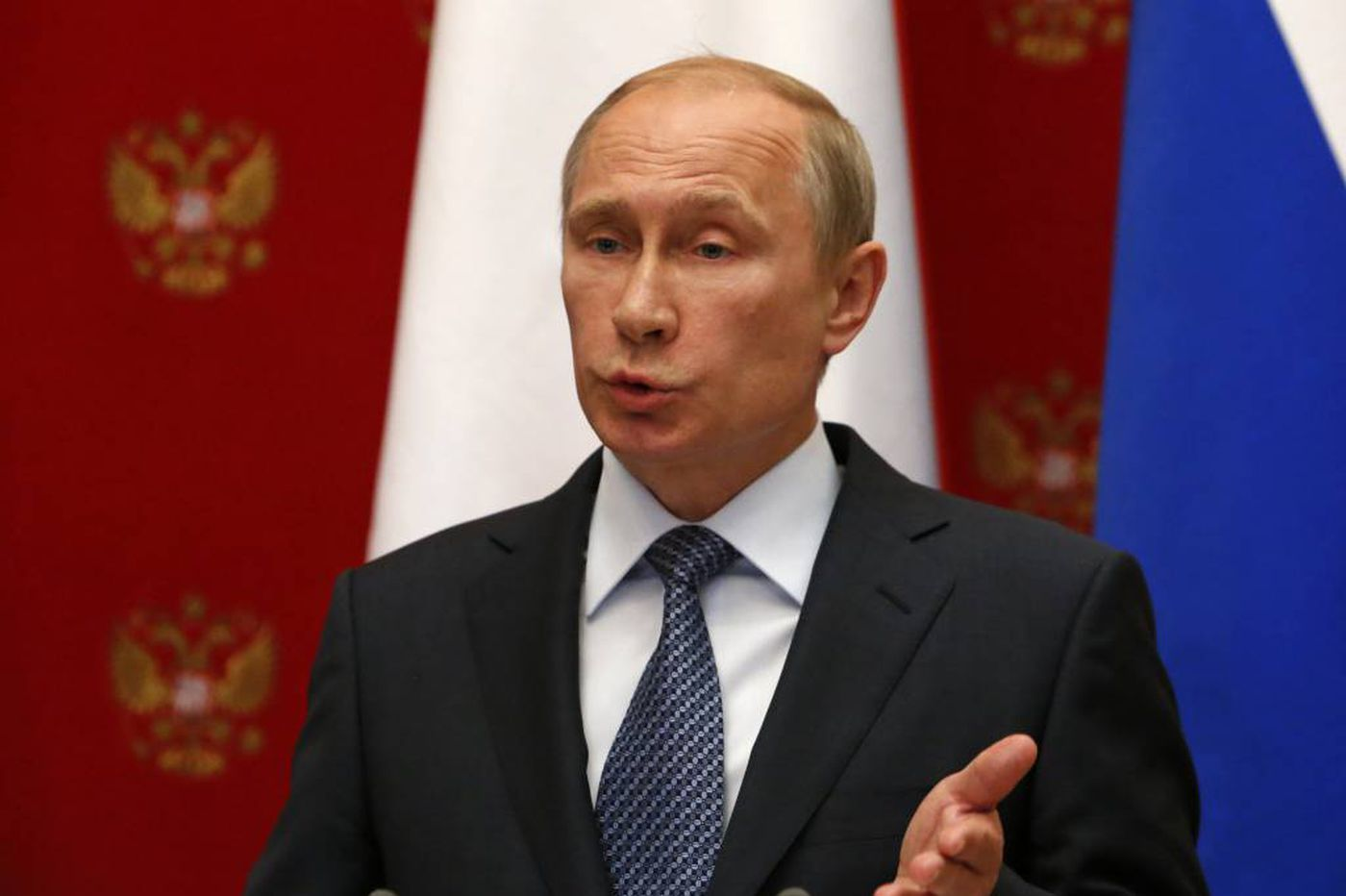 Putin tells separatists to back off Ukraine referendum