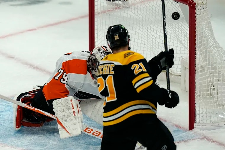 Carter Hart, shown here giving up a goal on Thursday, tied a dubious career high on Saturday by allowing six goals in the Flyers' disappointing 6-1 loss   at Boston. Afterward, he was visibly frustrated.