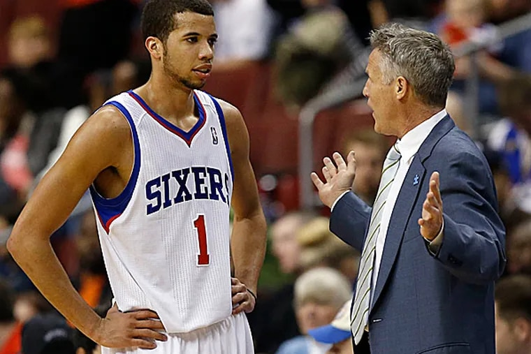 Sixers point guard Michael Carter-Williams and head coach Brett Brown. (Yong Kim/Staff Photographer)