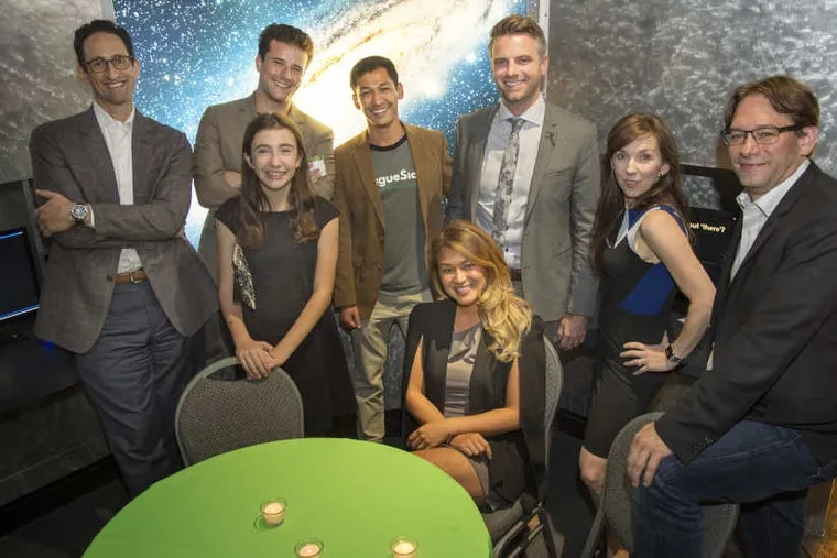 Some of the award winners of The Stellar StartUps pose for a photo after the ceremony at the Franklin Institute's Fels Planetarium September 12, 2017. In back row, from left are: Adam Holt, Asset-Map; Evan Brandon and Zubin Teherani,with LeagueSide; Brady Halligan, The GREEN Program; and Felicite Moorman and Ryan Buchert with StratIS. In front are Anna Welsh, little bags.BIGIMPACT and Melissa Lee (seated), The GREEN Program.