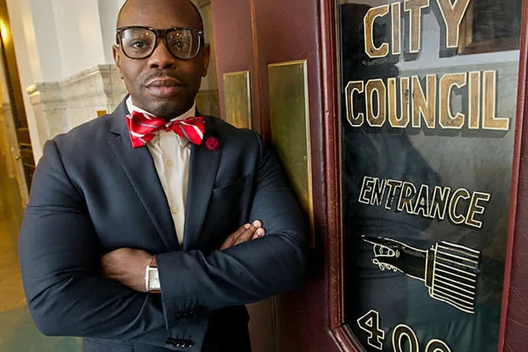 Lewis Thomas III stands yesterday in City Hall: His lies have ended his stints in education, so maybe politics will be a better fit.